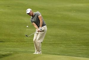 England's Willett plays a shot on the ninth hole during the BMW Masters 2012 golf tournament at Lake Malaren Golf Club in Shanghai