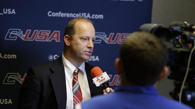 Western Kentucky head coach Jeff Brohm gives an interview during the NCAA college Conference USA football media day in Irving, Texas Wednesday, July 23, 2014. (AP Photo)
