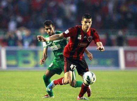 Zine Eddine of Algeria's USM Alger fights for the ball with Al-Farhan of Kuwait's Al-Arabi during the UAFA final soccer match in Algiers