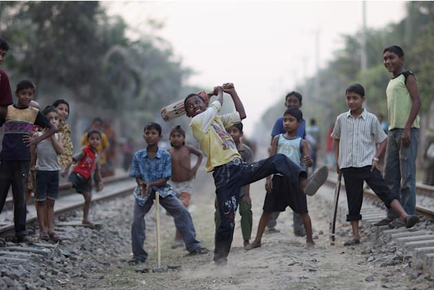 Bangladeshi Children Play Cricket On Railway Tracks In Chittagong