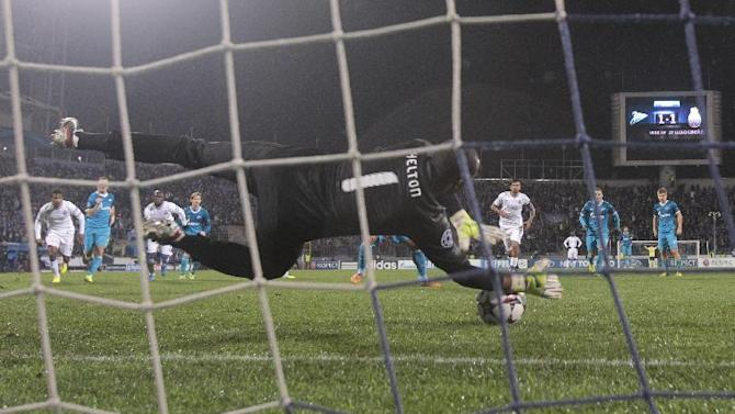 Porto's goalkeeper Helton makes a save on Zenit's Hulk's penalty kick during the Champions League group G soccer match between Zenit and Porto at Petrovsky stadium in St.Petersburg, Russia, Wednesday, Nov. 6, 2013