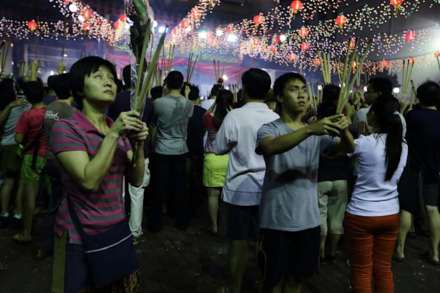 SINGAPORE - FEBRUARY 10: Worshippers gather to pray at the Kwan Im Thong Hood Cho Temple on Lunar New Year on February 10, 2013 in Singapore. Thousands gathered today to celebrate the Chinese New Year and welcome the the Year of the Snake, with new year's day falling on February 10. Chinese new Year is the most important festival in the Chinese calendar and is celebrated in Singapore and many other Southeast Asian countries with significant Chinese Populations. (Photo by Suhaimi Abdullah/Getty Images)