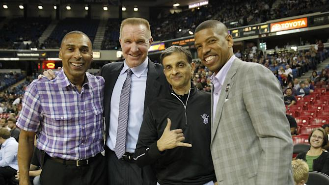 Former San Francisco 49ers running back Roger Craig, left, NBA Hall of Fame guard Chris Mullen, second from left, Sacramento Kings majority owner Vivek Ranadive, third from left and Sacramento Mayor Kevin Johnson, right, pose for a photo before the start of the Kings NBA preseason basketball game against the Los Angeles Clippers in Sacramento, Calif., Monday, Oct. 14, 2013.  The Kings beat the Clippers 99-88.  Johnson encouraged Ranadive to purchase the Kings and keep the team in Sacramento