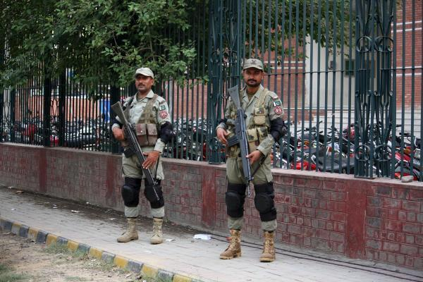 LAHORE, May 22, 2015 (Xinhua) -- Pakistani rangers stand guard outside the Gaddafi Cricket Stadium in eastern Pakistan's Lahore, May 22, 2015. Pakistan and Zimbabwe will play the first Twenty20 In
