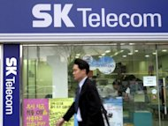 South Korea's largest mobile phone carrier SK Telecom said Wednesday its first-quarter net profit fell 40 percent year-on-year due to cuts in phone fees