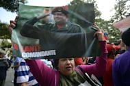 Supporters of Venezuelan President Hugo Chavez gather at Simon Bolivar Square in Caracas on February 18, 2013. Chavez surprised and in many cases delighted Venezuelans by returning home, albeit to an uncertain future, ending a more than two-month absence in Cuba for cancer treatment