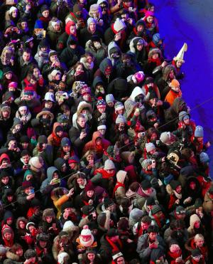 RETRANSMISSION TO CORRECT DAY TO TUESDAY - Looking from the Marriott Marquis hotel, people crowd into Times Square for New Year's Eve celebrations in New York Tuesday, Dec. 31, 2013. (AP Photo/Craig Ruttle)