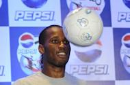 Ivory Coast striker Didier Drogba, seen here in New Delhi, said that an announcement on his future was due shortly as he side-stepped questions about whether it lay with China's Shanghai Shenhua