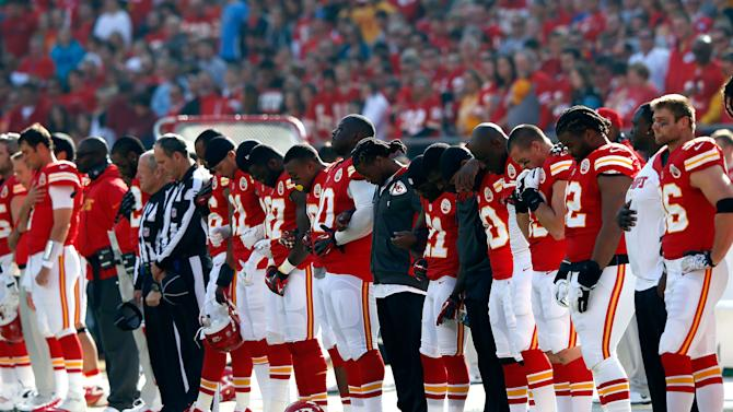KANSAS CITY, MO - DECEMBER 02: The Kansas City Chiefs pause for a moment of silence honoring domestic abuse after the incident involving Jovan Belcher #59 prior to the game at Arrowhead Stadium on December 2, 2012 in Kansas City, Missouri. (Photo by Jamie Squire/Getty Images)