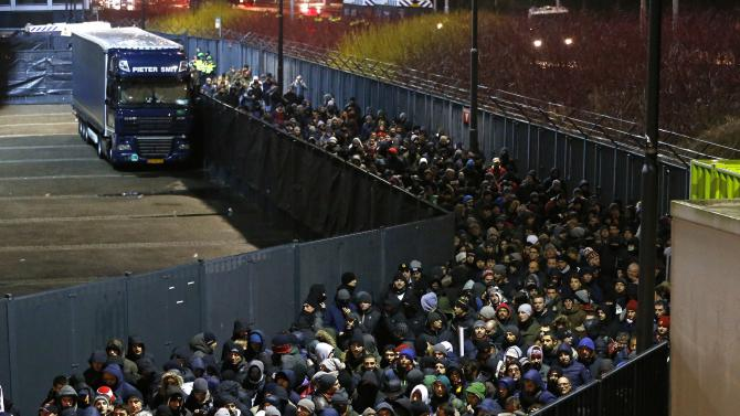 AS Roma fans leave the Kuip stadium through a secured corridor after the Europa League soccer match against Feyenoord in Rotterdam
