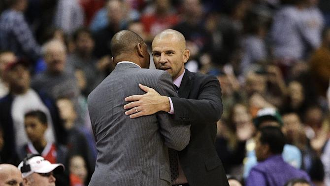 Los Angeles Clippers' Doc Rivers, left, and Brooklyn Nets' Jason Kidd hug after an NBA basketball game on Saturday, Nov. 16, 2013, in Los Angeles. The Clippers won 110-103