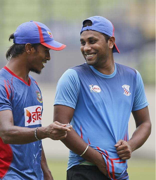 Bangladesh's Rubel Hossain, left, and Suhag Gazi share a lighter moment during a practice session ahead of their first Twenty20 cricket match against South Africa in Dhaka, Bangladesh, Wednesday, July