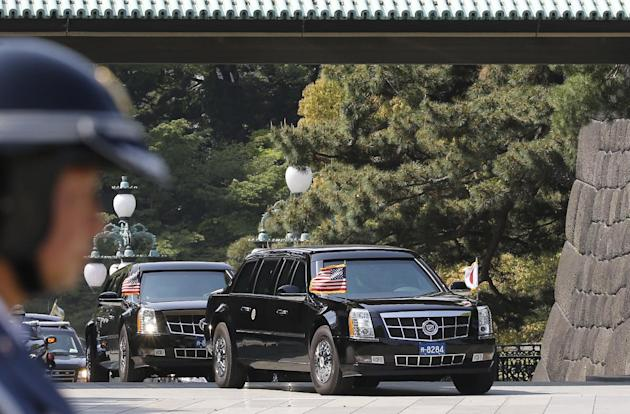 A limousine carrying U.S. President Barack Obama arrives at the Imperial Palace for a welcome ceremony in Tokyo Thursday, April 24, 2014. Facing fresh questions about his commitment to Asia, Obama wil
