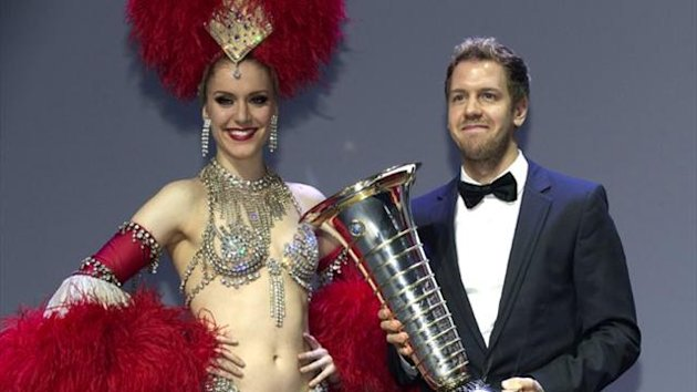 Sebastian Vettel holds his trophy at the 2013 FIA Prize Giving gala in Saint-Denis (Reuters)