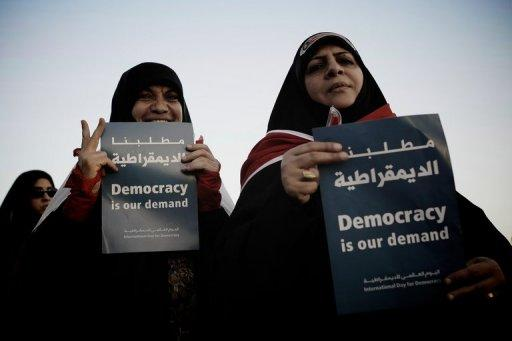 """Bahraini Shiite Muslim women hold signs during an anti-government rally in the village of Shakhora, west of Manama, on September 14. Bahrain said Wednesday it accepted """"90 percent"""" of reforms urged by the UN Human Rights Council (HRC) in the wake of a popular uprising, amid US criticism that the kingdom was dragging its feet"""