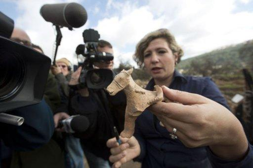 Israel Antiquities Authority archeologist Anna Ririkh displays on December 26, 2012 a clay figurine used for religious rituals and practices, dated to the early monarchic period (9-10th century. BC) of the Judaean monarchy, uncovered in Tel Motza near Jerusalem during rescue excavations