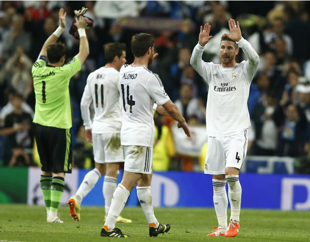 Real's Sergio Ramos celebrate with teammates at the end of a first leg semifinal Champions League soccer match between Real Madrid and Bayern Munich at the Santiago Bernabeu stadium in Madrid, Spa