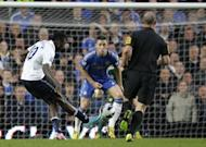 Tottenham Hotspur's Emmanuel Adebayor (L) shoots to score past Chelsea defender Gary Cahill during a Premier League match at Stamford Bridge, on May 8, 2013. Tottenham can't afford to drop points at Stoke on Sunday as Andre Villas-Boas's fifth placed side try to keep the pressure on Chelsea and fourth placed Arsenal