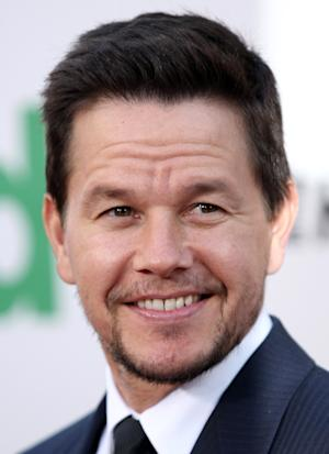 """FILE - In this June 21, 2012 file photo, cast member Mark Wahlberg arrives at the premiere for """"Ted,"""" in Los Angeles. """"Transformers"""" director Michael Bay says the 41-year-old actor, Wahlberg, will star in the upcoming fourth """"Transformers"""" film. (Photo by Matt Sayles/Invision/AP, File)"""
