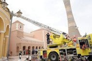 Qatari firefighters and rescue teams work outside Doha's Villagio Mall after a fire broke out at the Gulf emirate's main shopping centre on May 28, killing at least 19 people, including 13 children, and two members of the civil defence