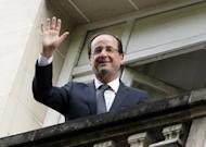 France's president-elect Francois Hollande waves from his Parisian balcony. European and world leaders have reached out to Hollande, France's first Socialist head of state in 17 years, despite jitters about his pledge to renegotiate Europe's austerity pact