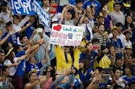 Chelsea fans cheer during a training session at the Rajamangala stadium in Bangkok, on July 16, 2013. Thailand has denied a father's claim that a boy chosen as a mascot for English giants Chelsea had been forced to make way for the prime minister's football-mad son