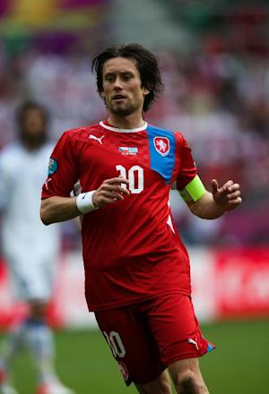Tomas Rosicky (Achilles) played down fears his absence would have a dramatic impact on his Czech Republic team-mates
