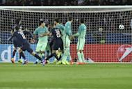 Paris Saint-Germain's Angel Di Maria (left) scores from a free kick during the Champions League match against Barcelona on February 14, 2017
