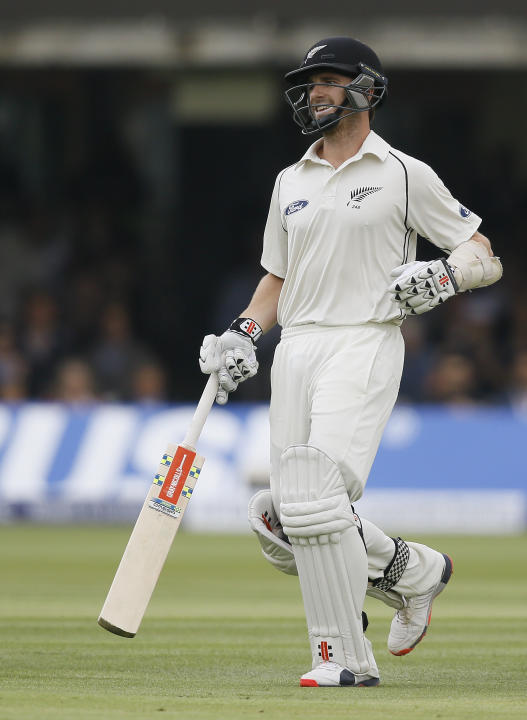 New Zealand's Kane Williamson smiles as he runs to score a century during the third day of the first Test match between England and New Zealand at Lord's cricket ground in London, Saturday, Ma