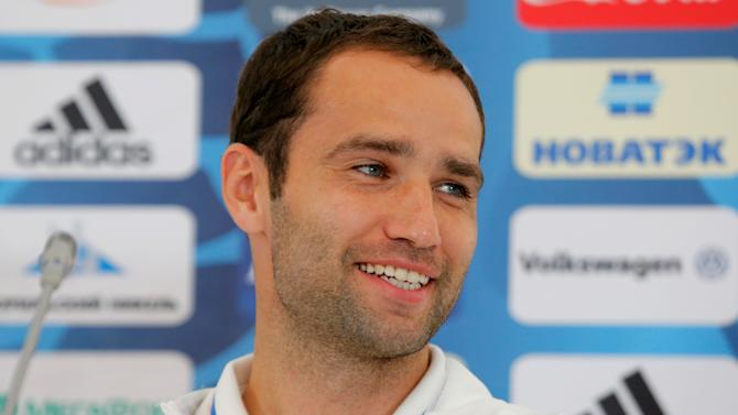 Russia's Shirokov smiles during a news conference prior to the national soccer team's departure to the Euro 2016 soccer tournament in France at Moscow's Sheremetyevo airport