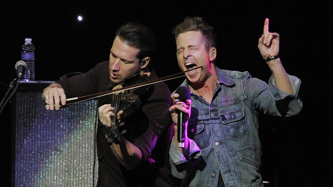 FILE - In this Dec. 1, 2012 file photo, Zach Filkins, left, and Ryan Tedder of the band OneRepublic perform at KIIS FM's Jingle Ball at Nokia Theatre LA Live  in Los Angeles. (Photo by Chris Pizzello/Invision/AP)