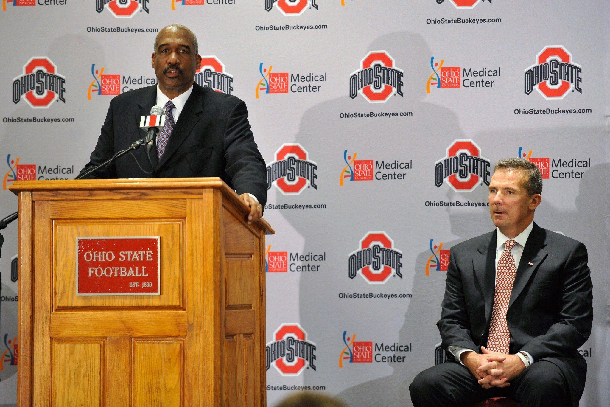 Ohio State AD Gene Smith introduced Urban Meyer as the team's coach in 2011. (Getty)