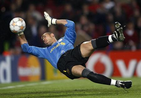 Barcelona's goalkeeper Victor Valdes blocks a ball against Schalke 04 during their Champions League quarter-final second leg soccer match at Camp Nou stadium in Barcelon