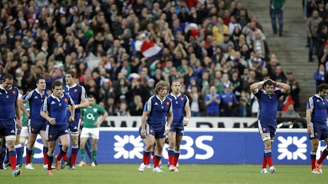 France's rugby team players after missing a try during the Six Nations Rugby Union tournament at the stade de France stadium, in Saint Denis, outside Paris, Saturday, March 15, 2014