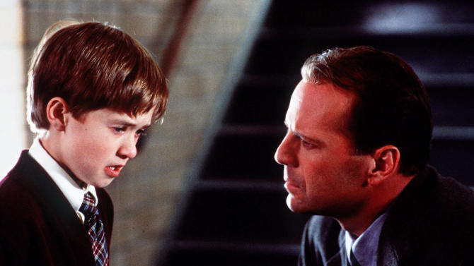 """FILE - In this publicity photo released by Spyglass Entertainment, Haley Joel Osment, left, and Bruce Willis appear in a scene from the film """"The Sixth Sense,"""" a tale of a child who can see ghosts. (AP Photo/Spyglass Entertainment, Ron Phillips, File)"""