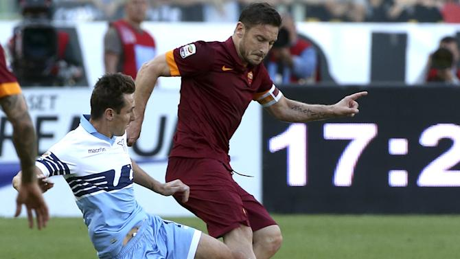 AS Roma's Totti challenges Lazio's Klose during their Serie A soccer match at the Olympic stadium in Rome