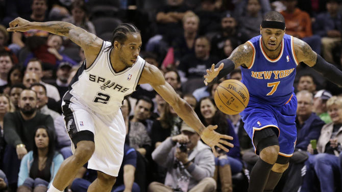 San Antonio Spurs' Kawhi Leonard (2) and New York Knicks' Carmelo Anthony (7) chase a loose ball during the first half on an NBA basketball game, Thursday, Jan. 2, 2014, in San Antonio. (AP Photo/Eric Gay)