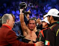 Juan Manuel Marquez celebrates after defeating Manny Pacquiao by a sixth round knockout in their welterweight bout at the MGM Grand Garden Arena on December 8, 2012 in Las Vegas, Nevada
