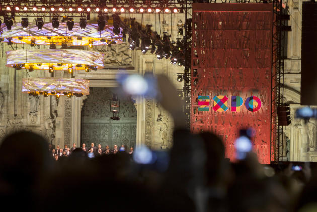 People take pictures during the Expo 2015 inaugural concert in Milan, Italy, Thursday, April 30, 2015. Milan's Expo 2015 world's fair has heady ambitions, the biggest of which is to devise a p