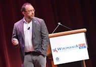"Wikipedia founder Jimmy Wales speaks during ""Wikimania 2012"" international Wikimedia conference July 12, at the Lisner Auditorium in Washington, DC. At the ""Wikimania"" event held in Washington over the past week, several hundred members of the ""wiki"" community gathered for talks about the site and a two-day ""hackathon,"" aimed at improving Wikipedia"