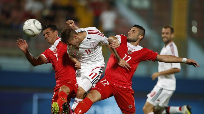 Denmark's Falk attempts to score as Malta's Failla and Camilleri challenge him during their World Cup qualifying soccer match in Ta' Qali
