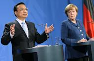 German Chancellor Angela Merkel (R) and China's Prime Minister Li Keqiang give a press conference at the Chancellery in Berlin, Germany, on May 26, 2013. Merkel and Li urged Sunday for talks to avert brewing trade spats between Beijing and the EU, warning that protectionist measures would hurt both sides