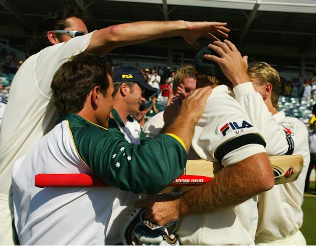 Matthew Hayden of Australia is congratulated by team mates after breaking Brian Lara of The West Indies world record of 375