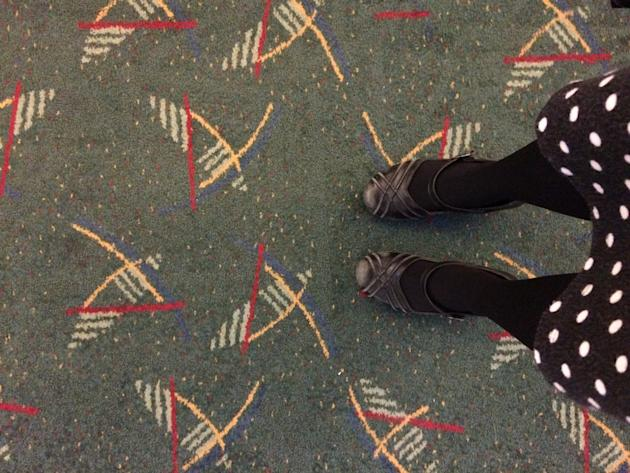 This selfie taken by Julie Sabatier Jan. 16, 2015, at Portland International Airport in Portland, Ore., shows her feet on new carpet recently installed at the terminal.  After enduring three decades o