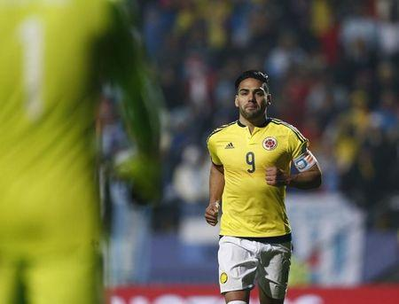 Colombia's Falcao runs towards Colombia's goalie Ospina after scoring in penalties against Argentina after the end of regulation play in