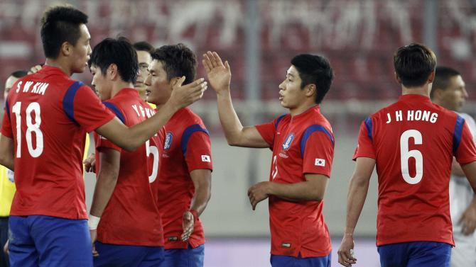 South Korea's players celebrate their victory after their international friendly soccer match against Greece at Karaiskaki stadium in Piraeus, near Athens