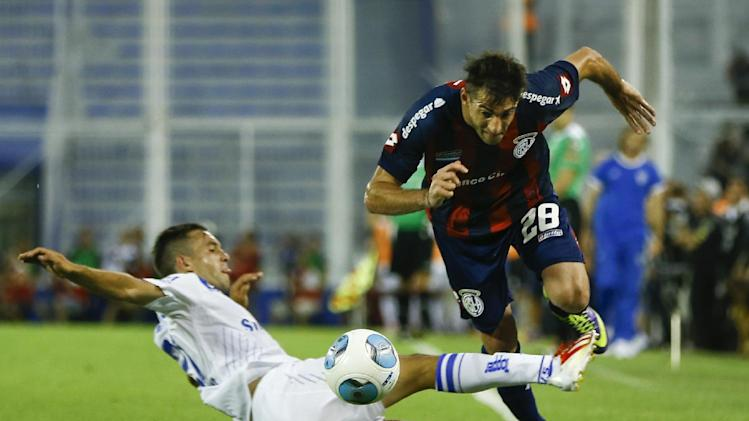 Velez Sarsfield's Agustin Allione, left, vies for the ball against San Lorenzo's Ignacio Piatti, right, during an Argentina league soccer match in Buenos Aires, Argentina,  Sunday, Dec. 15, 2013