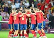 Spanish players celebrate after winning the Euro 2012 football championships final match Spain vs Italy at the Olympic Stadium in Kiev