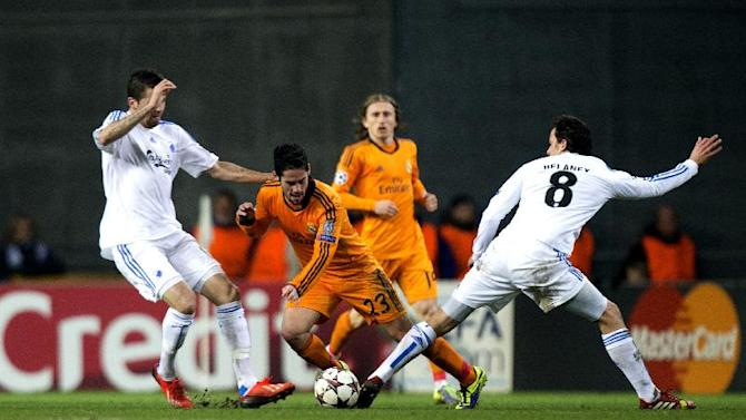 Real Madrid's Isco Suarez vies for the ball between FC Copenhagen's Claudemir, left and Thomas Delaney during the Champions League, Group B, soccer match between FC Copenhagen and Real Madrid, at Parken in Copenhagen, Denmark, Tuesday Dec. 10, 2013
