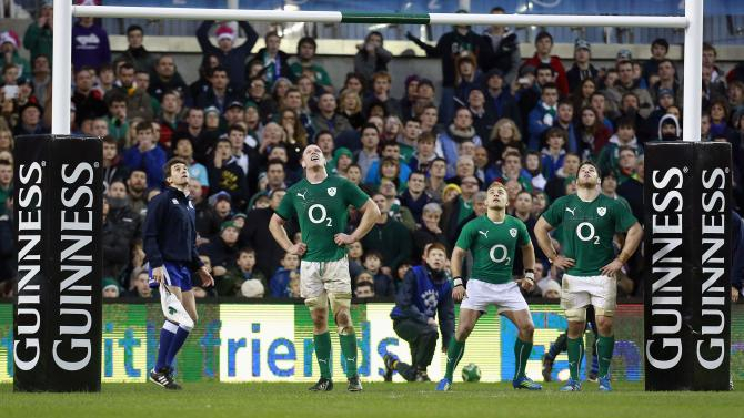 Ireland players look on as New Zealand's Aaron Cruden converts a try in their International rugby union match in Dublin